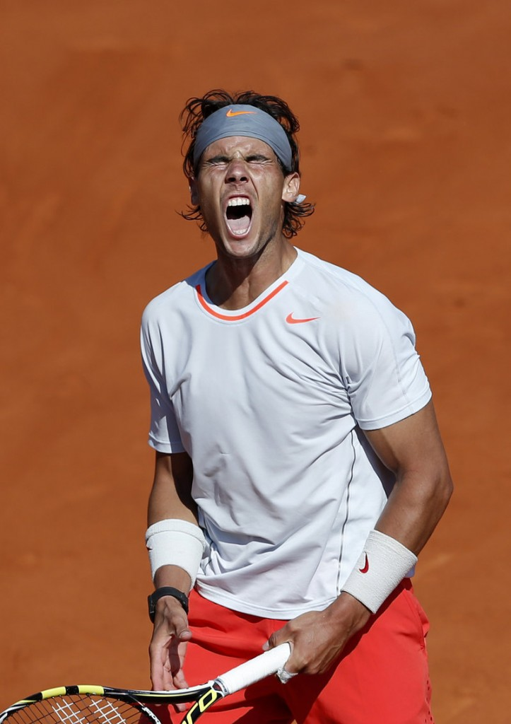 Rafael Nadal roars with authority during Thursday's marathon match against Novak Djokovic at the French Open.