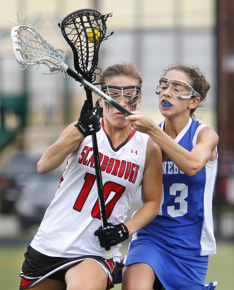 Sophie Joseph of Kennebunk plays close defense on Jessica Meader of Scarborough during the second half of Kennebunk's 9-7 victory Saturday.