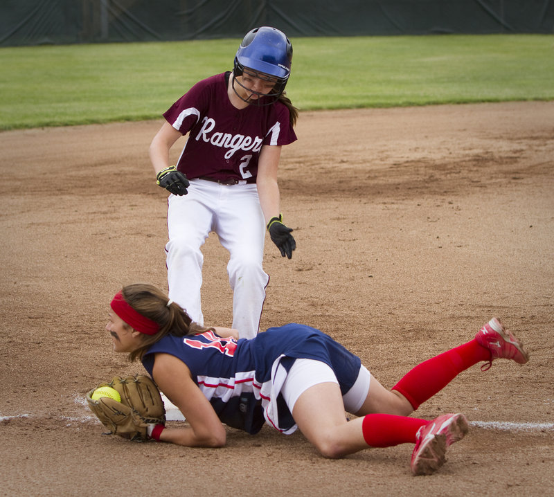 Samantha Wilkins of Gray-New Gloucester dives on third to force out Greely's Evan Carrell in Wednesday's game.