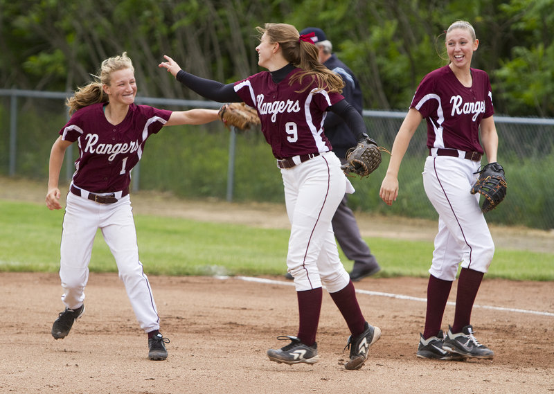 A double play is a pitcher's best friend, and also time to celebrate as Greely second baseman Alexa Faietta, left, and pitcher Dani Cimino do so in the fifth inning Wednesday as first baseman Mykaela Twitchell looks on.