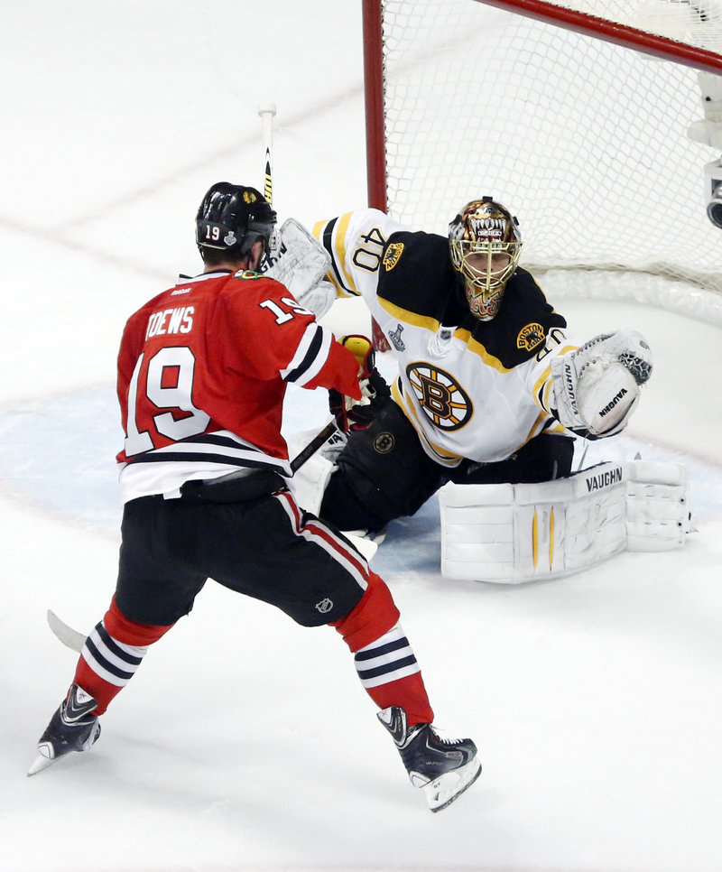 Bruins goalie Tuukka Rask makes a glove save as Chicago's Jonathan Toews waits for a rebound during the second period Wednesday night.