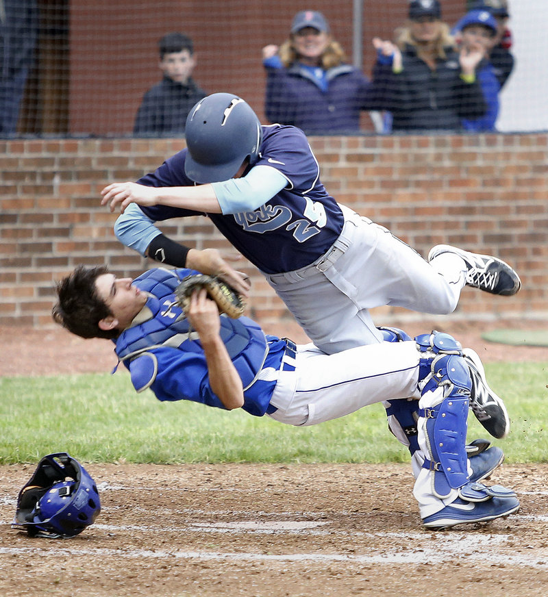 Daniel Bock, York's starting pitcher, crashes into Falmouth catcher Connor MacDowell while trying to score in the top of the fourth inning. Bock was ejected, but relievers Aaron Todd and Adam Bailey protected York's lead over the last four innings.