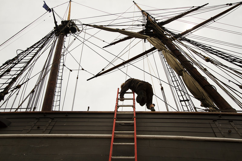 A crew member works on the former slave ship Amistad in dry dock at Gowen Marine in Portland on Thursday June 13, 2013.
