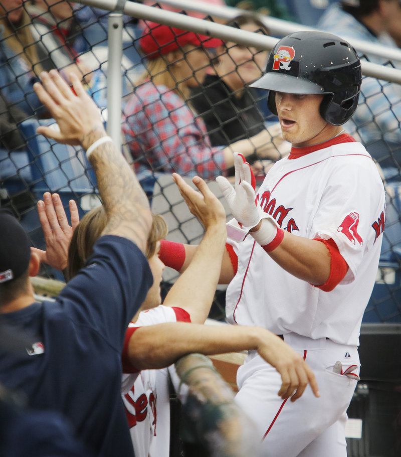 Shannon Wilkerson is met by teammates after scoring on a first-inning double by Michael Almanzar for the only run the Sea Dogs would need to beat the Erie SeaWolves.
