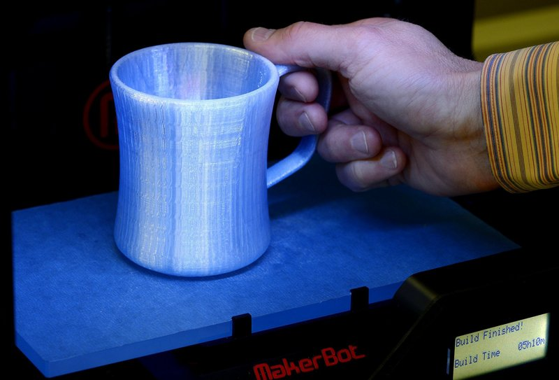 "It took five hours and 10 minutes to ""print"" this coffee mug at the Prototype Studio at Hallmark in Kansas City, Mo. The technology that makes this possible is becoming omnipresent and companies and ideas are booming."