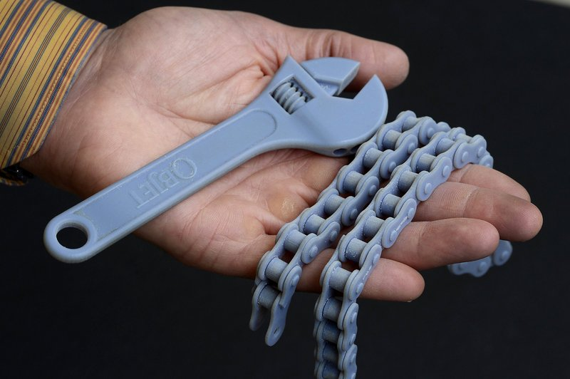 A wrench and a bicycle chain were created by 3-D printing at the Prototype Studio at Hallmark in Kansas City, Mo.
