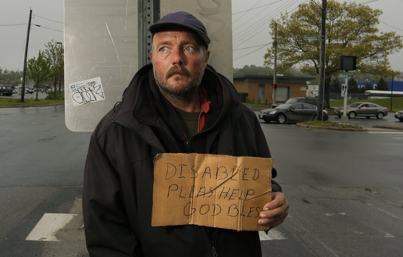 Don Dietz panhandles for change at Franklin Street and Marginal Way in Portland in May. A reader is skeptical about the concerns cited by people who favor a ban on panhandling in city medians.
