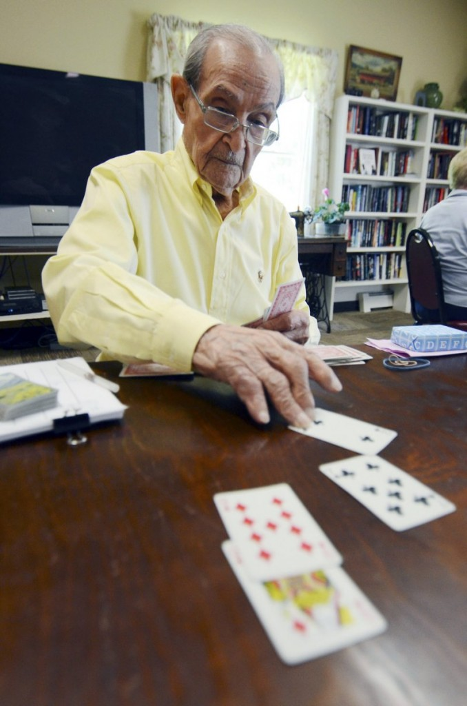 Joe Tuzzo, 104, plays bridge at the Claire Teague Senior Center in Great Barrington, Mass. Tuzzo describes himself as a formidable bridge player, but he is known as the man to beat as a wordsmith.
