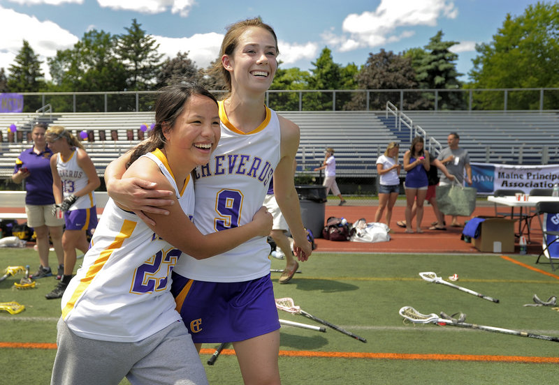 Hope Correia, left, and Meredith Willard embrace after Cheverus edged Massabesic 8-7 Saturday at Fitzpatrick Stadium for the Stags' first Class A girls' lacrosse state title.