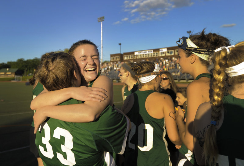 Katherine Torrey, 33, embraces teammate Isabel Agnew after Waynflete completed a perfect season with a 7-4 victory against Yarmouth in the Class B girls' lacrosse state championship game at Fitzpatrick Stadium.