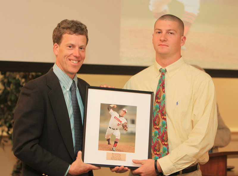 Scarborough's Ben Greenberg, the baseball player of the year, receives his framed photo from sports writer Glenn Jordan.
