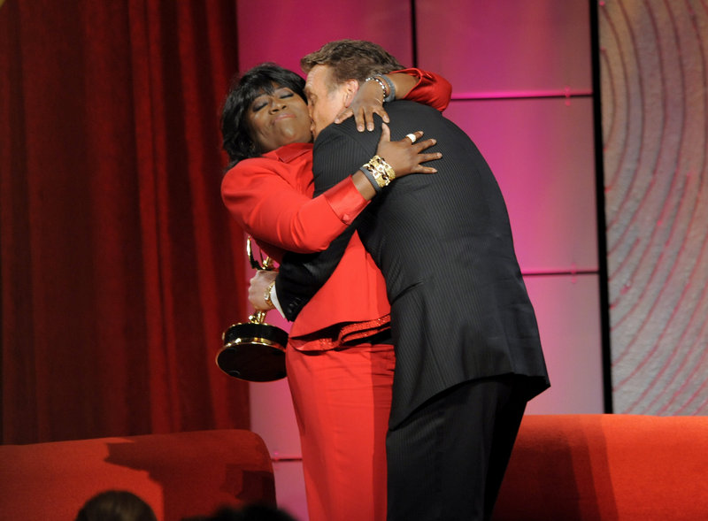"""Sheryl Underwood hugs Doug Davidson, winner of the award for outstanding lead actor in a drama series for """"The Young and the Restless."""""""
