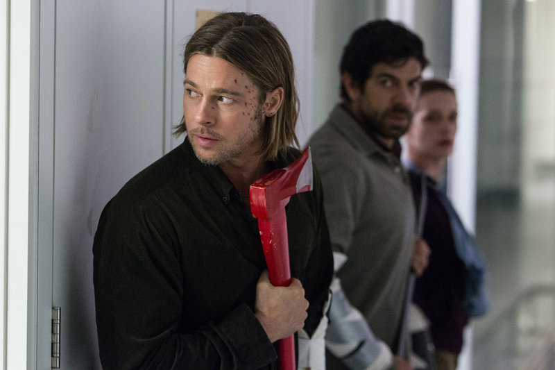 """Brad Pitt, top, and with Daniella Kertesz, above, in scenes from """"World War Z."""""""
