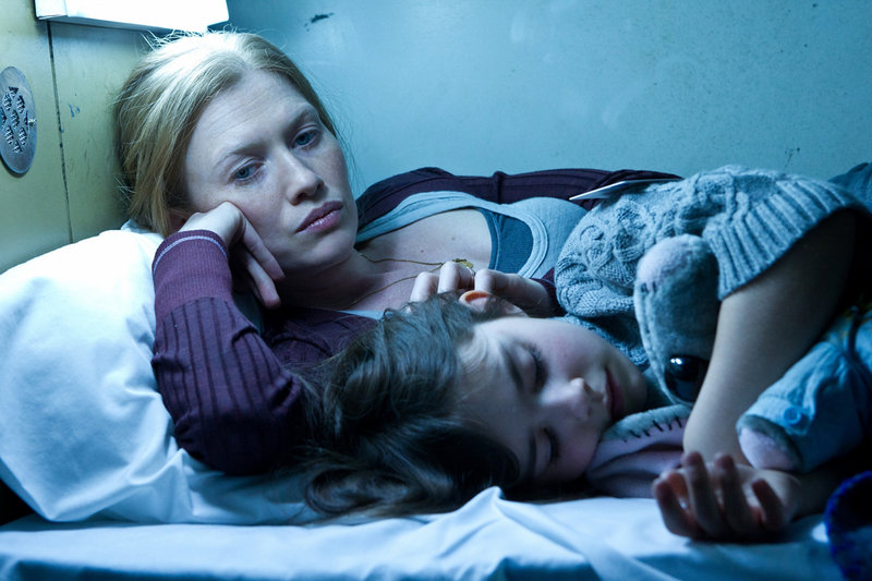 """Mireille Enos and Sterling Jerins in a scene from """"World War Z."""""""