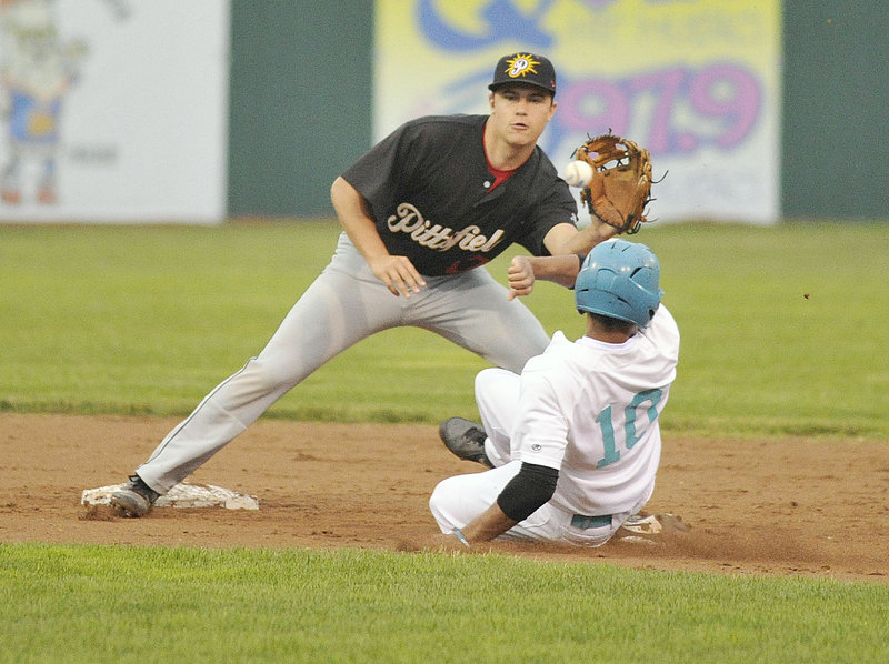 John Kinne of the Pittsfield Suns takes the late throw as Aaron Wilson of the Old Orchard Beach Raging Tide steals second base in the second inning.