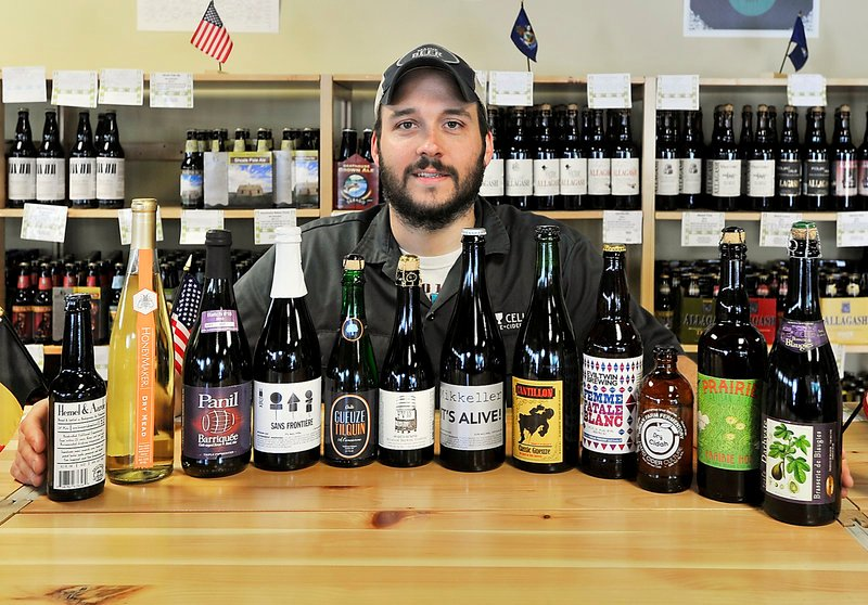 Greg Norton, owner of Bier Cellar at 299 Forest Ave., displays a large variety of beers, plus a mead and hard cider, that will be featured this weekend during The Festival at The Portland Company on Fore Street.