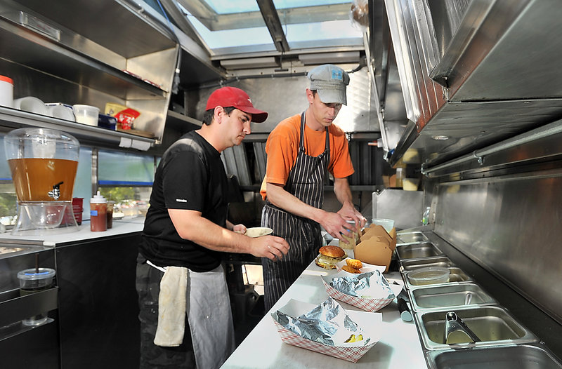 Bill Leavy, left, and Karl Deuben are the Small Axe owners and cooks.