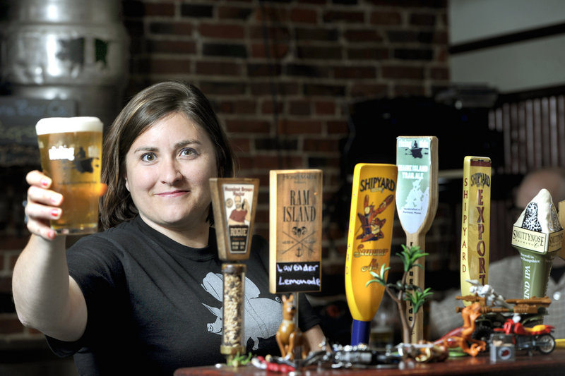 """Allison Stevens pours a draft Wednesday at her bar, The Thirsty Pig on Exchange Street in Portland, in advance of the beer celebration known as The Festival. The international event serves as a showcase for the """"rock stars"""" of the craft beer world."""