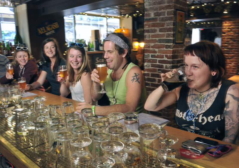 Customers – from left, Sarah Jump, Biz Wing, Erika Colby, Brian Gallant and Helen Walden –enjoy the selections at Novare Res Bier Cafe in Portland on Wednesday. A swarm of beer lovers is expected to visit the city this weekend.