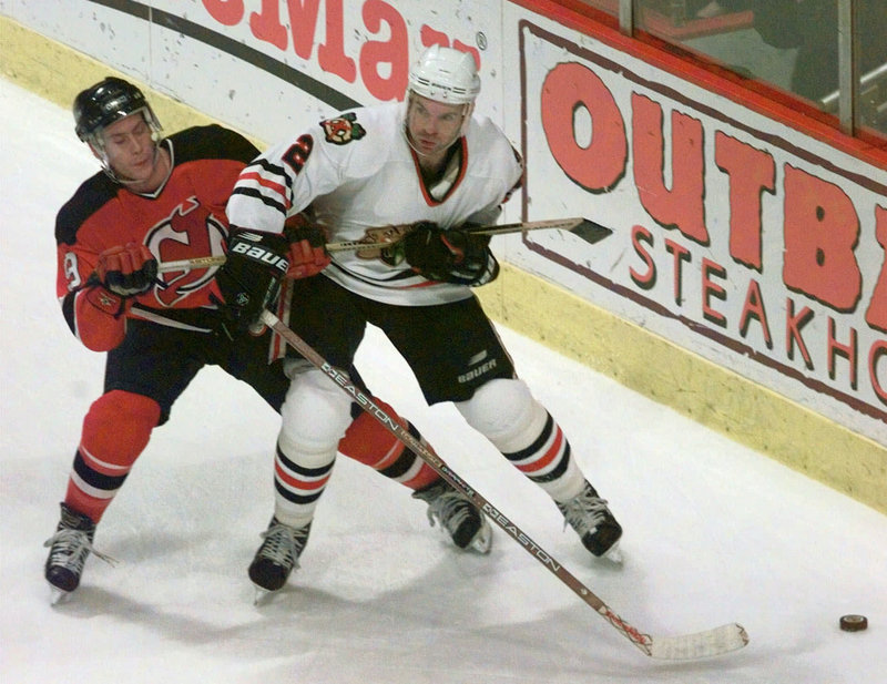 Eric Weinrich, right, who starred at North Yarmouth Academy and the University of Maine, plays for Chicago in 1998, the last of his five seasons with the Blackhawks.