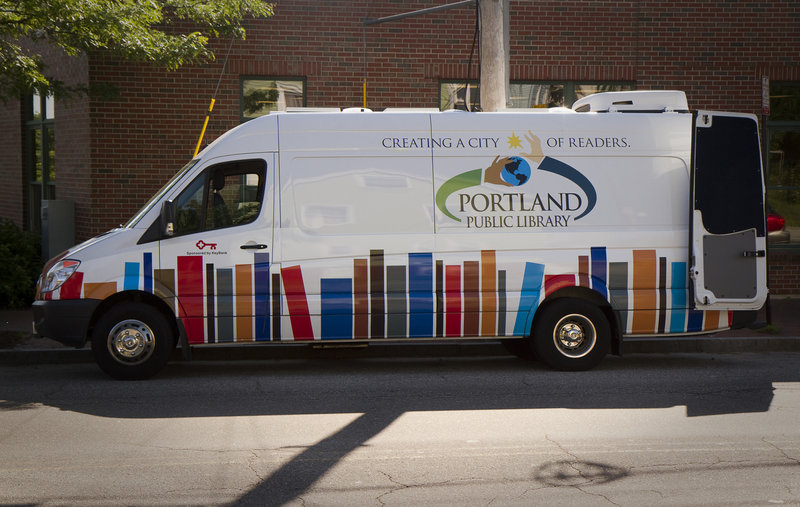 Portland Public Library's mobile unit parks in front of The Root Cellar on Washington Avenue in Portland on Friday, June 21, 2013. The mobile unit will make regular visits around Portland throughout the summer, supplying books to kids over the summer vacation.