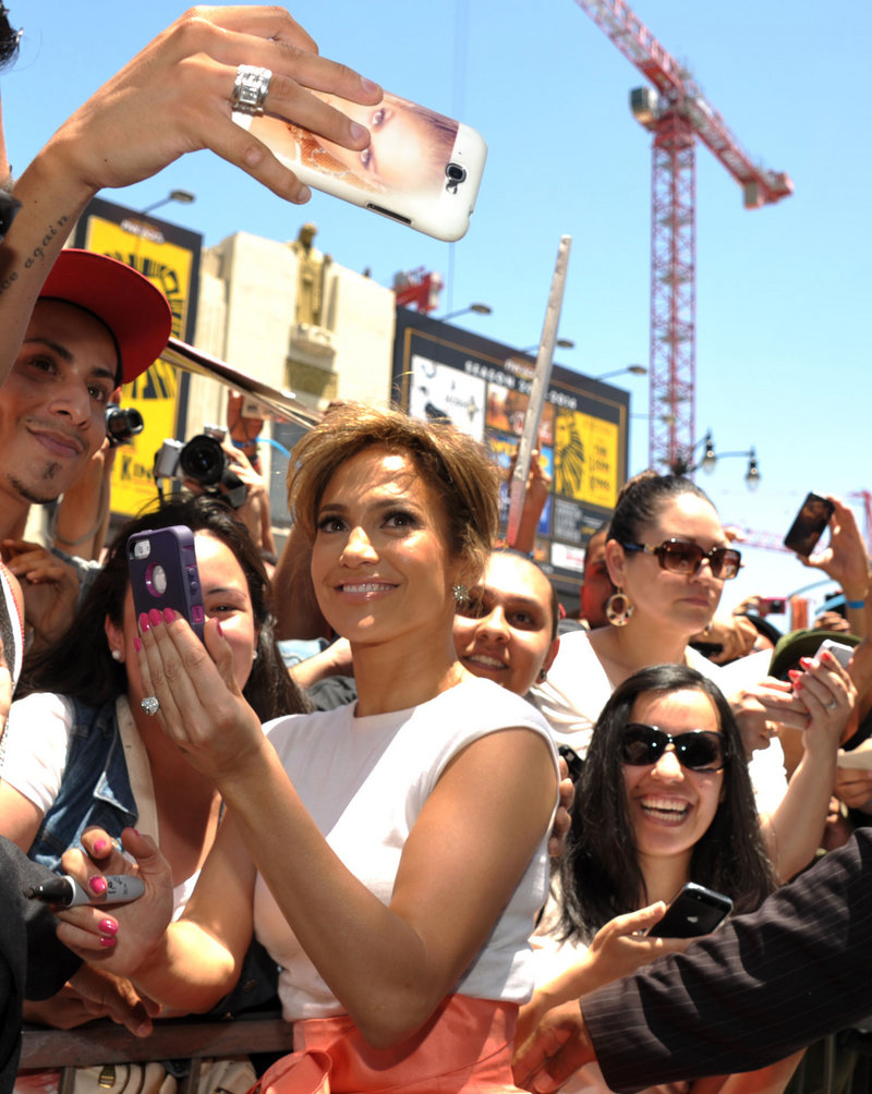Jennifer Lopez greets fans at a ceremony honoring her with a star on the Hollywood Walk of Fame.