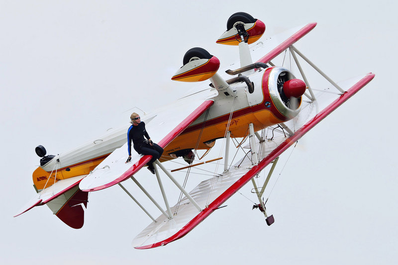 Wing walker Jane Wicker performs at the Vectren Air Show, above, Saturday in Dayton, Ohio. Moments after the picture was taken, the plane made a quick turn and nosedived, below.