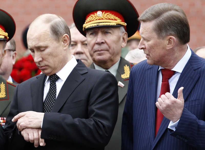 """Russia's President Vladimir Putin, left, shown at a ceremony in Moscow on Saturday, made it clear Tuesday that Russia won't expel Edward Snowden, who as a transit passenger """"is entitled to buy a ticket and fly to wherever he wants."""""""