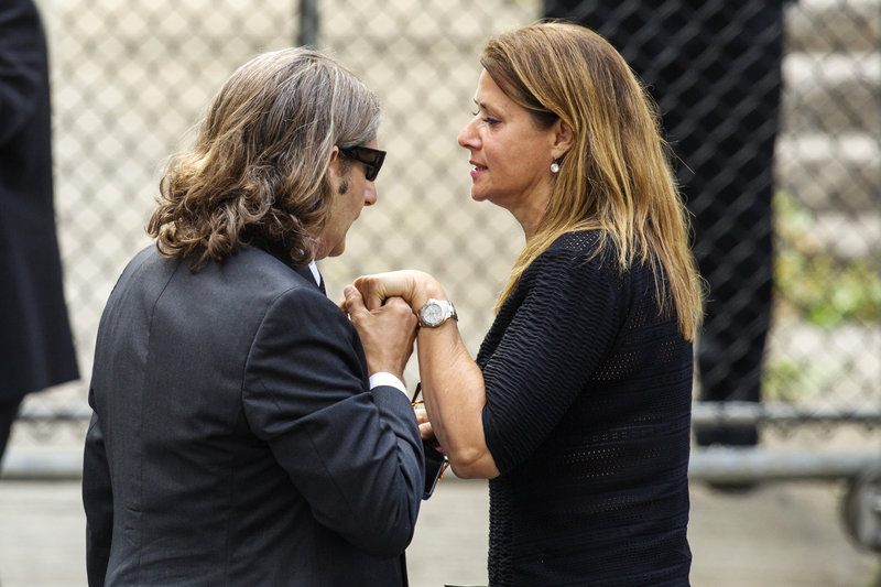 "Actor Michael Imperioli holds actress Lorraine Bracco's hand Thursday as they arrive for James Gandolfini's funeral services in New York. Both had roles in ""The Sopranos"" along with Gandolfini."