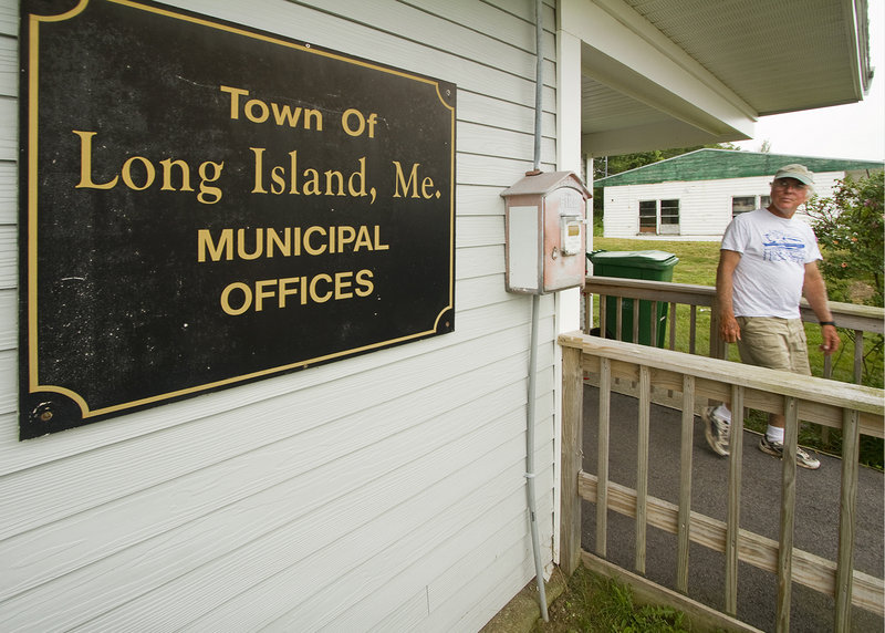 Long Island resident Mark Greene leaves the Municipal Offices building, which the town acquired after it seceded from Portland.