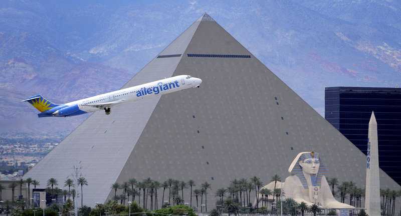 An Allegiant Air jetliner flies by the Luxor Resort & Casino after taking off from McCarran International Airport in Las Vegas. While other U.S. airlines have struggled with the ups and downs of the economy and fuel prices, tiny Allegiant Air has been profitable for 10 straight years.
