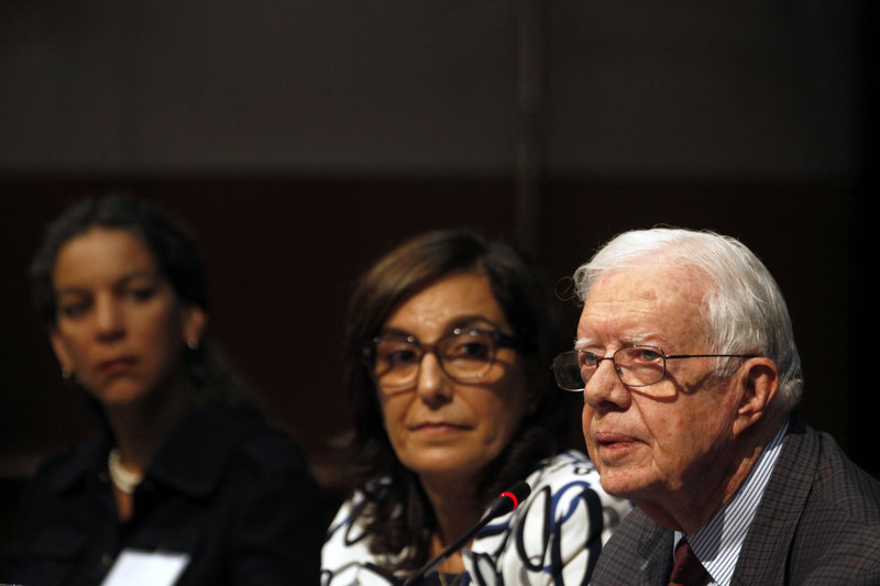 Former President Jimmy Carter presents his opening remarks during a conference on advancing women's rights at The Carter Center in Atlanta on Friday. Carter said religious leaders share the blame for the mistreatment of women and girls across the world.