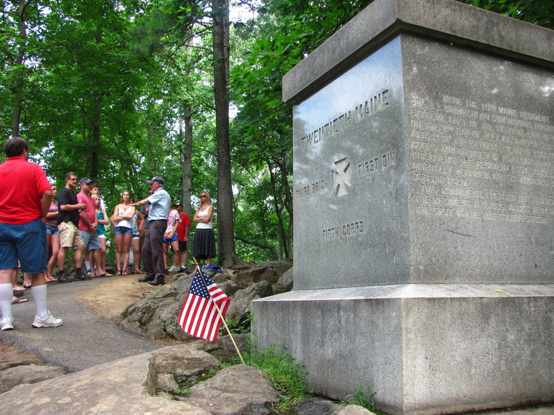 """A tour guide Sunday discusses the 20th Maine Regiment's bayonet charge on Little Round Top, which thwarted Confederate attempts to flank the Union lines at Gettysburg. Col. Joshua Chamberlain ordered the charge against the attacking forces because his troops were nearly out of ammunition and he was told to hold the far-left flank of the Union lines """"at all hazard."""""""