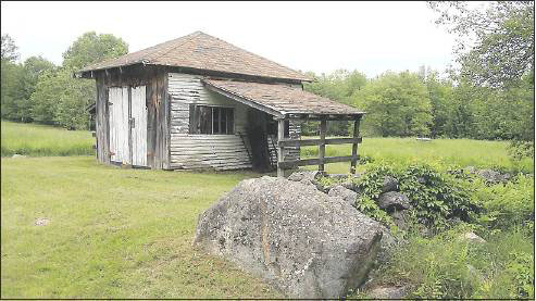 A resident of Roy Road in West Paris said police had taped off this shed on his property near where a state trooper shot James Reynolds, who was in critical condition Monday.