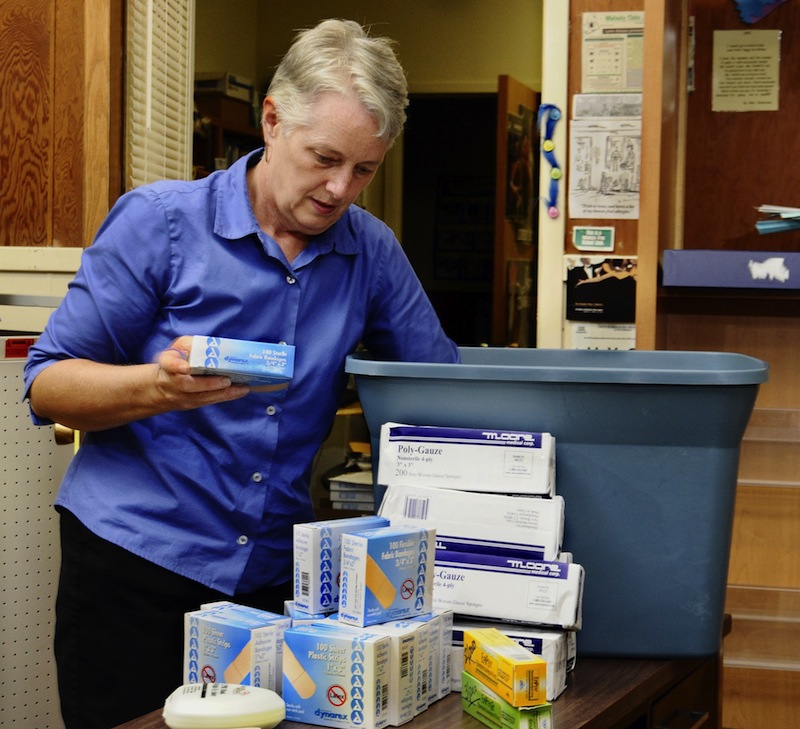 In this August 2009 file photo, Amanda Rowe, school nurse supervisor in Portland, prepares for the new school year with supplies for flu vaccinations. Rowe died Sunday, July 14, 2013 at 58 years old.