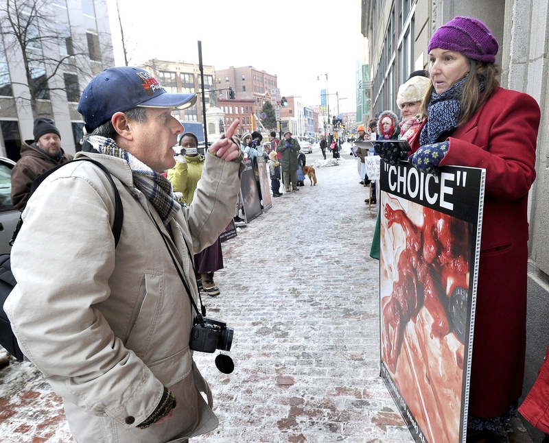In this January 2013 file photo, an anti-abortion protester and a pro-choice advocate exchange words in front of the Planned Parenthood clinic at 443 Congress St. in Portland.