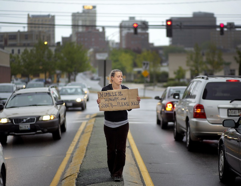 Alison Prior, 29, of Portland, panhandles at the corner of Preble Street and Marginal Way on Friday, May 24, 2013. In 30 days, it will be illegal for anyone to loiter in a Portland street median for any reason, including panhandling.