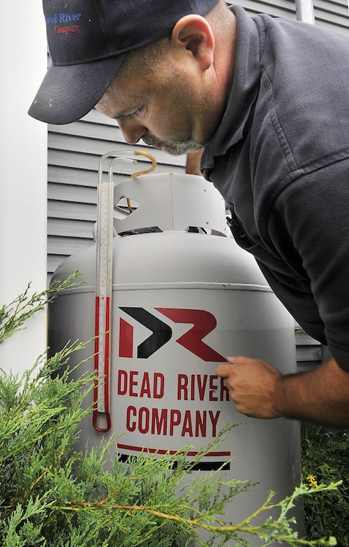 Mike Aboud, a service technician for Dead River Company, tests a propane system for leaks at a home in Scarborough on Friday, June 28, 2013.