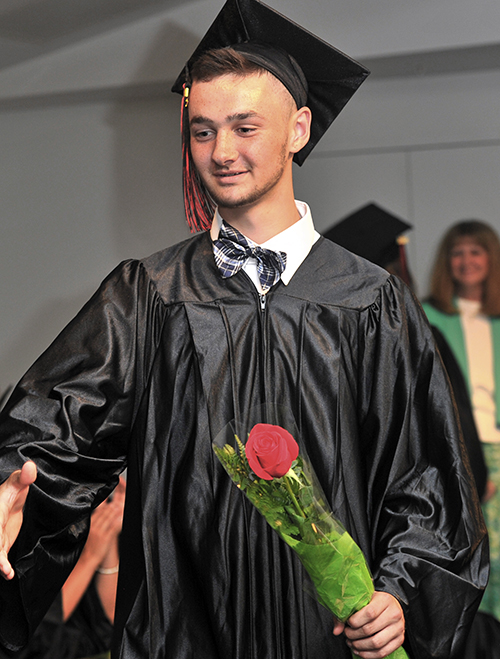 Andrew Annis was among those graduating from LearningWorks' Youth Building Alternatives on June 28, 2013.