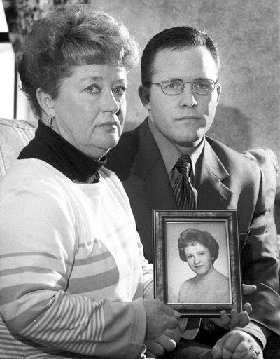 In this March 10, 2000, photo, Diane Dodd and son Casey Sherman hold a photo of Dodd's sister Mary Sullivan, who was found strangled in January 1964 and is believed to have been the last victim of the Boston Strangler.