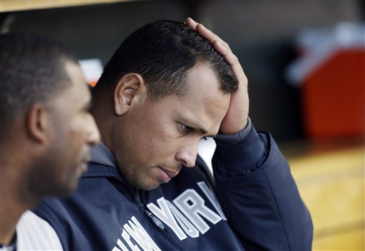 In this 2012 file photo, New York Yankees' Alex Rodriguez watches from the bench. Major League Baseball has reportedly offered the Yankees superstar an ultimatum: Accept a 1.5-year suspension without pay, or fight the charges and possibly never play again. (AP Photo/Paul Sancya)
