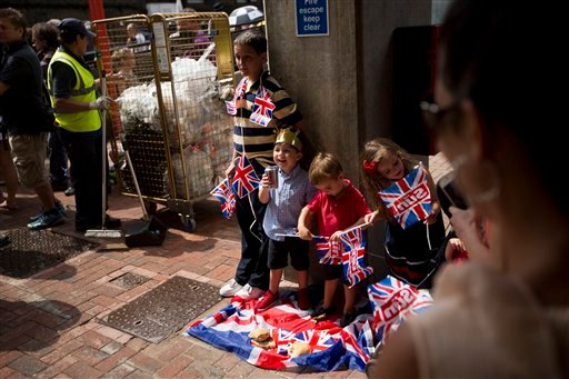 Children have an impromptu picnic as supporters await the departure of Britain's Prince William, Kate, Duchess of Cambridge, and the Prince of Cambridge, outside the entrance of the private Lindo Wing at St. Mary's Hospital in London on Tuesday.