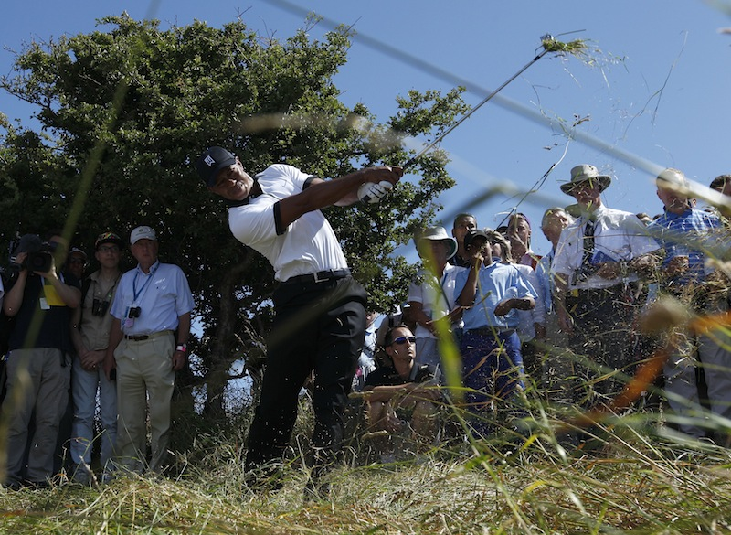 Tiger Woods of the United States plays out of the rough on the first fairway during the first round of the British Open Golf Championship at Muirfield, Scotland, on Thursday.