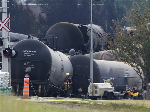 Cleanup continues at the scene of the Lac-Megantic, Quebec, runaway oil train derailment and explosion on Tuesday. Investigators looking for the cause of the fiery oil train derailment are zeroing in on whether an earlier blaze on the same train may have set off a chain of events that led to the explosions that killed at least 13 people.