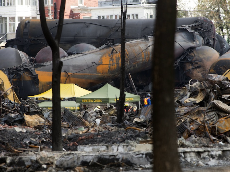 Work continues Tuesday, July 16, 2013, at the crash site of the train derailment and fire in Lac-Megantic, Quebec. The derailment July 6, 2013, left 37 people confirmed dead and another 13 missing and presumed dead. (AP Photo/The Canadian Press, Ryan Remiorz) Canada Quebec Montreal;transportation;business;Canada;Canadian;economic;economy;industry;move;ship;shipping;transit;transport;travel industry;commerce;tourism;fire;train;rail;derail;tragedy;disaster