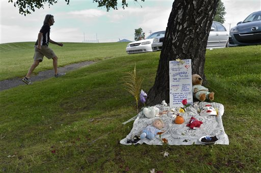 A makeshift memorial for victims of Saturday's oil train derailment and explosions is set up in Lac-Megantic, Quebec, on Wednesday.