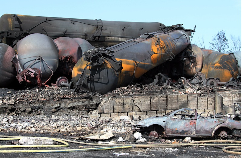 This photo provided by Surete du Quebec, shows wrecked oil tankers and debris from a runaway train on Monday, July 8, 2013 in Lac-Megantic, Quebec, Canada. A runaway train derailed igniting tanker cars carrying crude oil early Saturday, July 6 At least thirteen people were confirmed dead and nearly 40 others were still missing in a catastrophe that raised questions about the safety of transporting oil by rail instead of pipeline. (AP Photo/Surete du Quebec, The Canadian Press) Canada Quebec Montreal;transportation;business;Canada;Canadian;economic;economy;industry;move;ship;shipping;transit;transport;travel industry;commerce;tourism;fire;train;rail;derail;tragedy;disaster