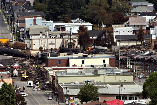 The investigation continues on Wednesday in Lac-Megantic, Quebec, where searchers have recovered at least 15 bodies from the wreckage so far, but they are so badly burnt that authorities have not been able to identify them.