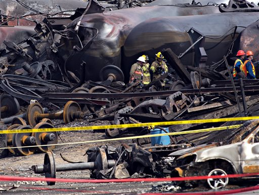 Crews move through the debris on Tuesday as cleanup work continues at the crash site of the train derailment and fire in Lac-Megantic, Quebec.