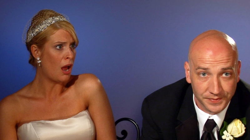 This image from video released by WE TV shows Kirsten Walker, left, and her husband Seth, a couple showcased on the sixth season of the popular wedding series